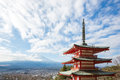 Red pagoda with mountain fuji japan landscape and yamanashi city as the background Royalty Free Stock Photos