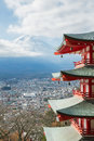Red pagoda with mountain fuji japan landscape and yamanashi city as the background Royalty Free Stock Images