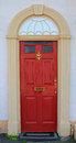 Red painted door, british house entrance Royalty Free Stock Photo