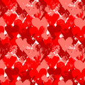 Red painted hearts on white seamless pattern, vector