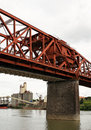 Red painted Steel truss draw bridge structure Stock Photo