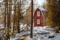 Red painted Swedish wooden house in a wintry landscape Stock Photo