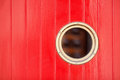 Red painted wood panels with a bull's eye Royalty Free Stock Photo