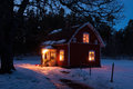 Red painted wooden house in Sweden at night Stock Images