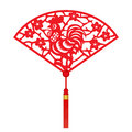 Red paper cut a chicken zodiac and flower in folding fans symbols Royalty Free Stock Photo