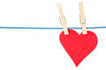 Red paper heart hang clothesline isolated over white background Stock Photos