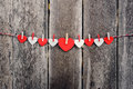 Red paper heart hanging on the clothesline old wood background valentine concept Stock Images