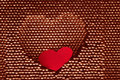 Red paper heart into steel herat shape Royalty Free Stock Image