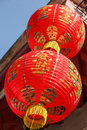 Red paper lanterns low angle view of two and gold outside building in bangkok thailand Royalty Free Stock Photo