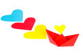 Red paper ship with heart shape and colored path of hearts Stock Images