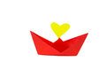 Red paper ship with heart shape on a white background Stock Images