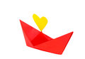 Red paper ship with heart shape on a white background Stock Photo