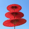 Red paper umbrella with blue sky background Royalty Free Stock Photo