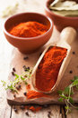 Red paprika powder spice in wooden scoop a Stock Photo