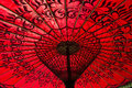 Red parasol detail of highlighted by the sun Royalty Free Stock Photo