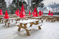 Red parasols with icecream logos outdoors in the spring kanaan minigolf cafe stockholm sweden Stock Photos