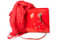 Red patent leather bag and bamboo scarf women s accessories on white background Royalty Free Stock Photography