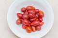 Red pear cherry tomatoes in a bowl top view Royalty Free Stock Photography