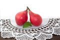 Red pears on old lace doily macro Royalty Free Stock Image