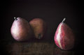 Red pears on a rustic wooden background Royalty Free Stock Image