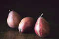 Red pears on a rustic wooden background Royalty Free Stock Photography