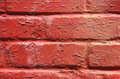 Red peeling paint on brick Royalty Free Stock Photo