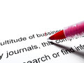Red pen correcting Royalty Free Stock Photo