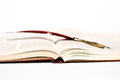 A red pen, on an open book now finished Royalty Free Stock Photo