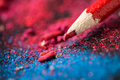 Red pencil on a bright colorful background Royalty Free Stock Image
