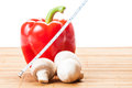 Red pepper champignon mushrooms and a white centimeter one measuring vegetable calories concept Stock Photo