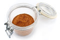 Red pepper powder in open jar Stock Photo