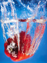 Red pepper splashing in water Stock Images