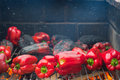 Red peppers roasting on the barbecue many Stock Photo