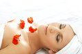 Red petals spa beautiful lady with flowers in Stock Photos