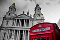 Red phone booth in front of st paul s cathedral in london Royalty Free Stock Photo