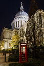 Red phone booth in front of st pauls cathedral london england Stock Photography