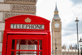 Red phone booth london uk telephone box near big ben england Stock Photography