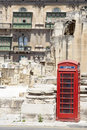 Red phone booth a at the royal opera house ruins in valletta malta Stock Photo