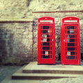Red phone boxes a pair of traditional britsh boxesagainst the wall of edinburgh castle scotland Royalty Free Stock Photos