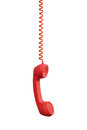 Red phone receiver hanging, isolated on white Royalty Free Stock Photo