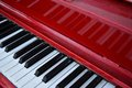 Red piano keyboard bright s with reflection of the keys in the paint this is a street free for all to play at a whim Royalty Free Stock Images