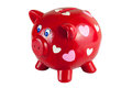 Red piggy bank with hearts isolated on white background clipping path included Stock Photography