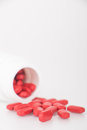 Red pills and pill bottle Royalty Free Stock Photos