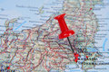 Red pin pointing  Tokyo on map in atlas Stock Photography