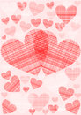 Red and pink hearts in a checkered pattern background of different sizes on colored ground Stock Photo