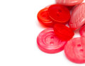 Red and pink sewing buttons empty space for your text Stock Images