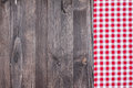 Red plaid cloth on dark wood a a wooden background Royalty Free Stock Image