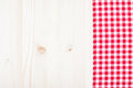 Red plaid cloth on white wood a a background Royalty Free Stock Images