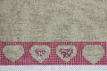 Red plaid country border with cutout hearts on burlap background Royalty Free Stock Photography
