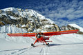 Red plane on a glacier Royalty Free Stock Photo